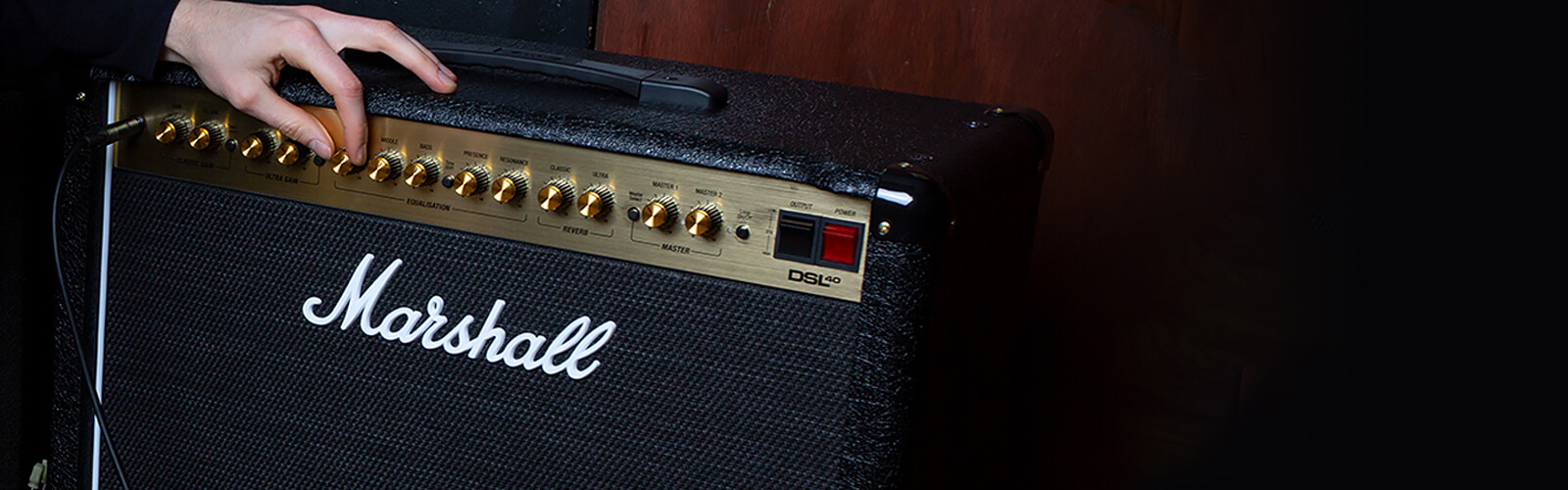 Marshall guitar amp being adjusted